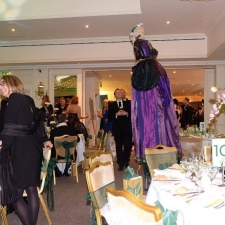 Madame Bovary (Stilt Walker) greeting guests